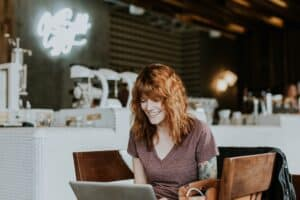 Woman in Coffee Shop with Laptop